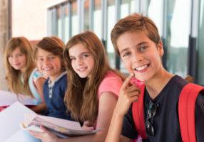 46711027 - group of happy little school kids in school